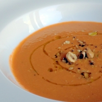 Raw Carrot and Avocado Soup with Toasted Hazelnuts
